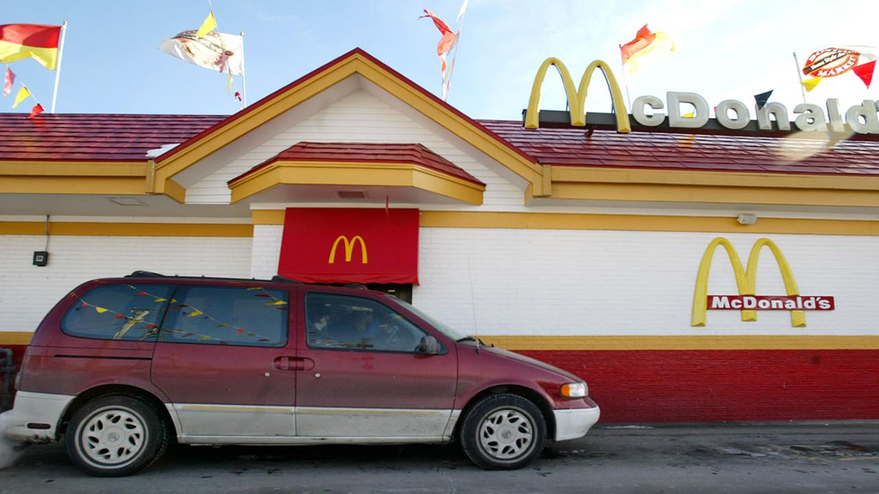 Patrons pull up to a drive-through-window Friday, Jan. 28, 2005, at a Chicago McDonalds fast-food restaurant.