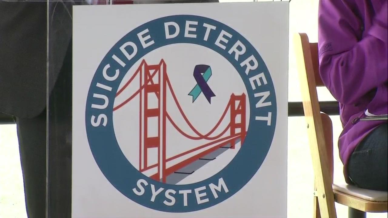 A sign for the Golden Gate Bridge suicide prevention barrier system is seen in San Francisco on Thursday, April 13, 2017.
