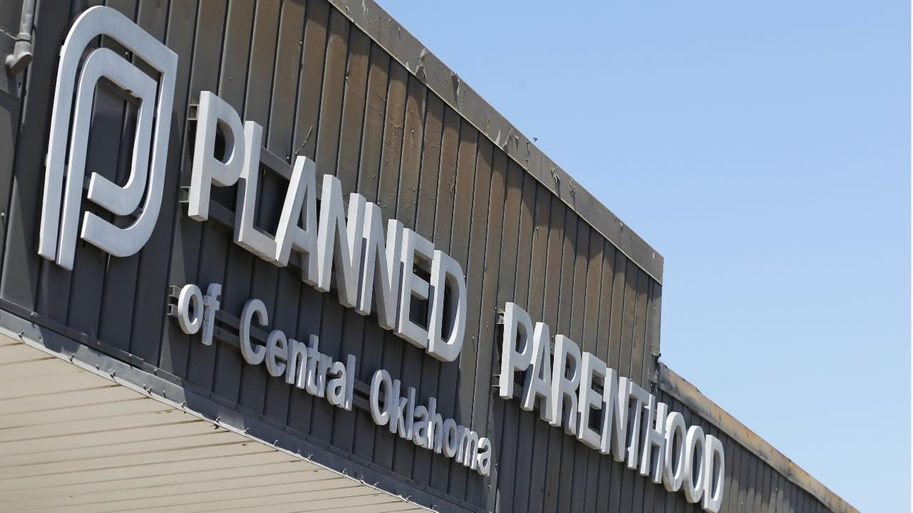 This July 24, 2015, file photo shows a sign at a Planned Parenthood Clinic in Oklahoma City.