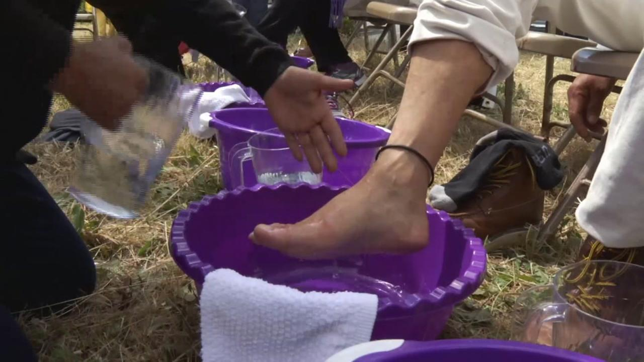 An immigrant foot washing ceremony takes place outside an ICE office in Morgan Hill, Calif. on Thursday, April 13, 2017.