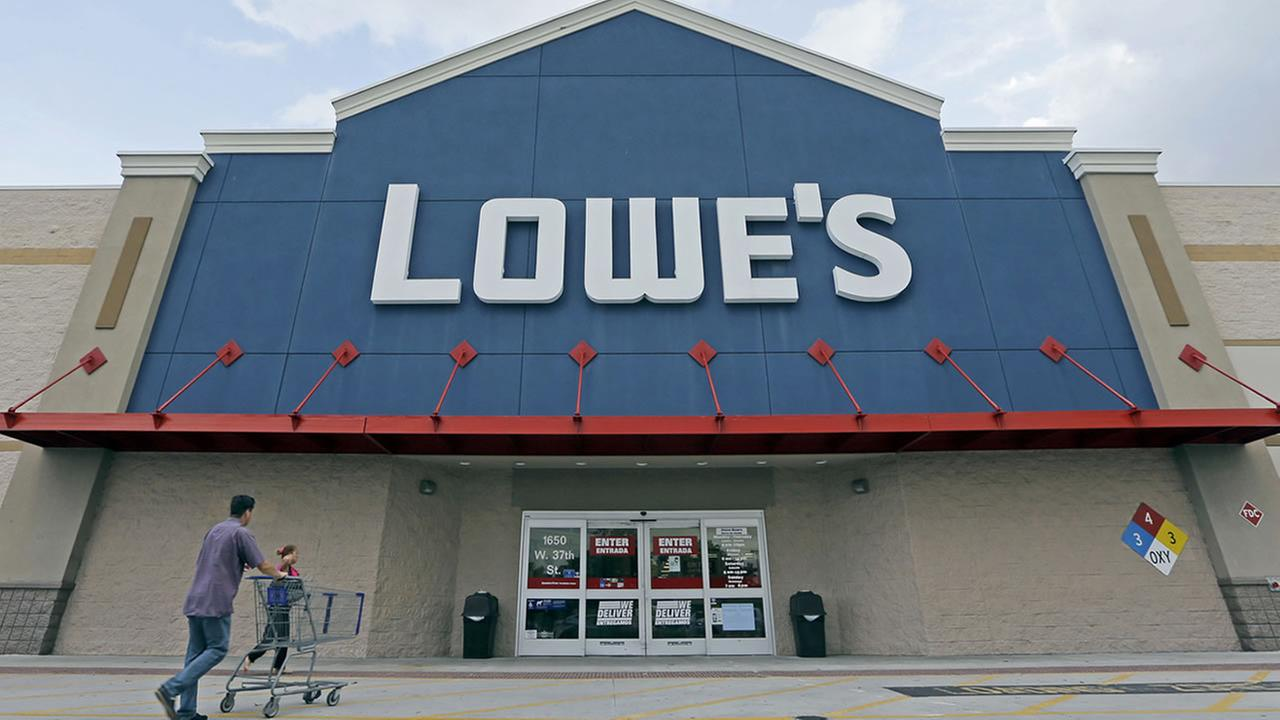 In this June 29, 2016, file photo, customers walk toward a Lowes store in Hialeah, Fla. Lowes reports financial results Wednesday, Nov. 16. (AP Photo/Alan Diaz, File)