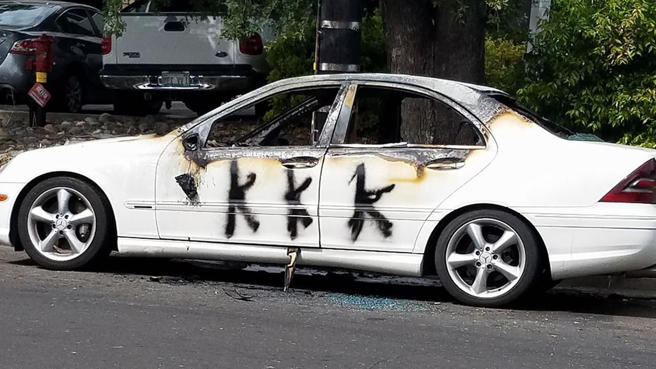 A car is seen marred with graffiti, showing signs of fire damage in Vacaville, Calif. on April, 25, 2017.