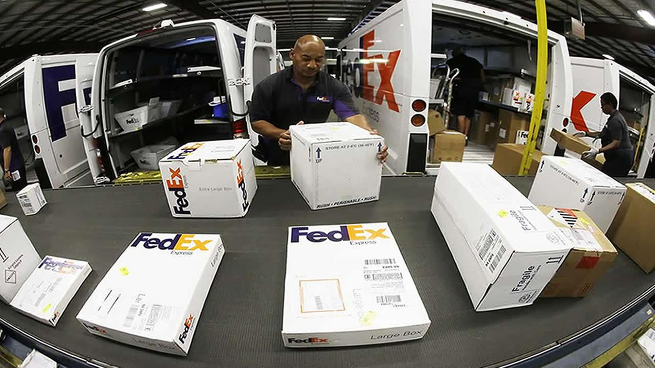 Fed Ex worker sorting package