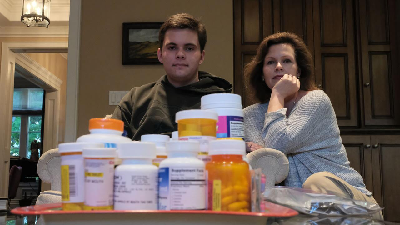 Louis Sheridan and his mother Kathleen ORourke sit near their Lyme Disease medication in Los Altos, Calif. on Monday, May 8, 2017.