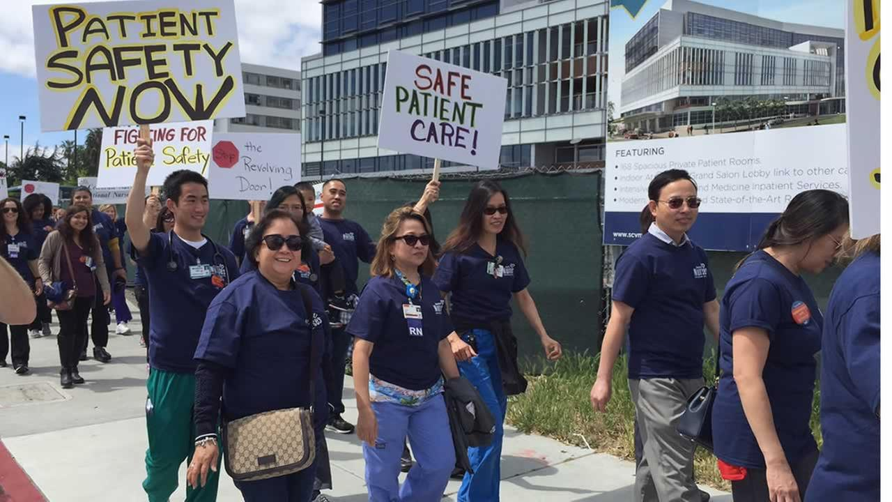 Nurses stage a protest march near Valley Medical Center in San Jose