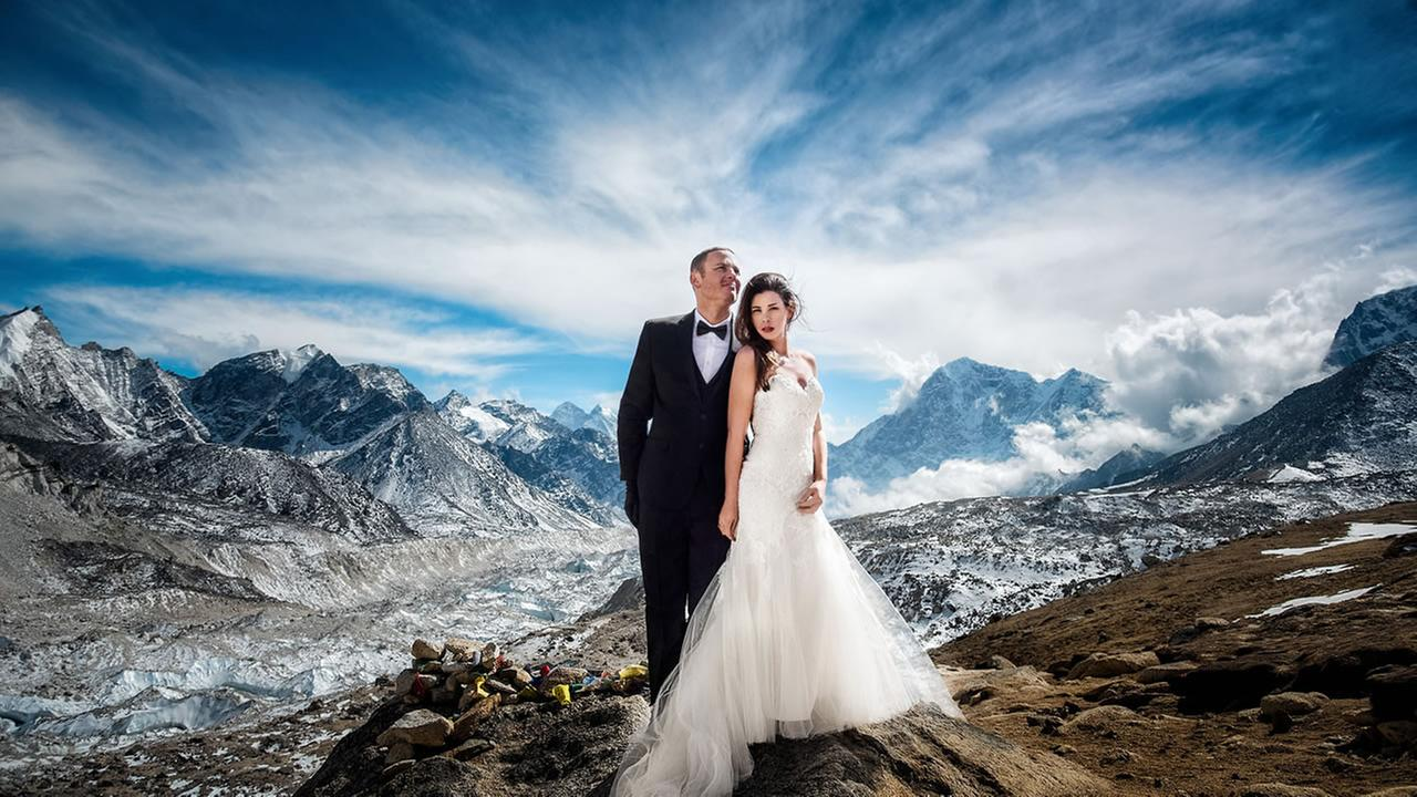 James Sissom, 35, and Ashley Schmieder, 32, stand on top of Mount Everest on their wedding day, March 16, 2017.