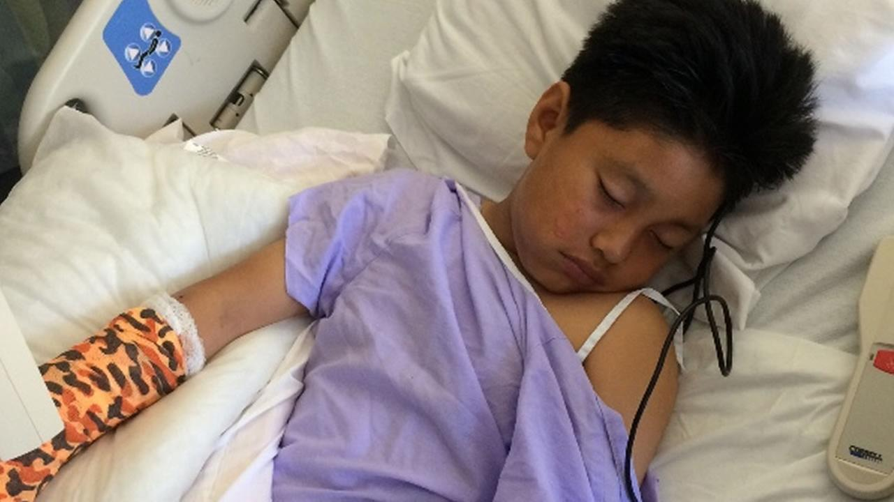 This photo shows Isai Catalan recovering in the hospital after being shot in Oakland, Calif. on Sunday, May 21, 2017.