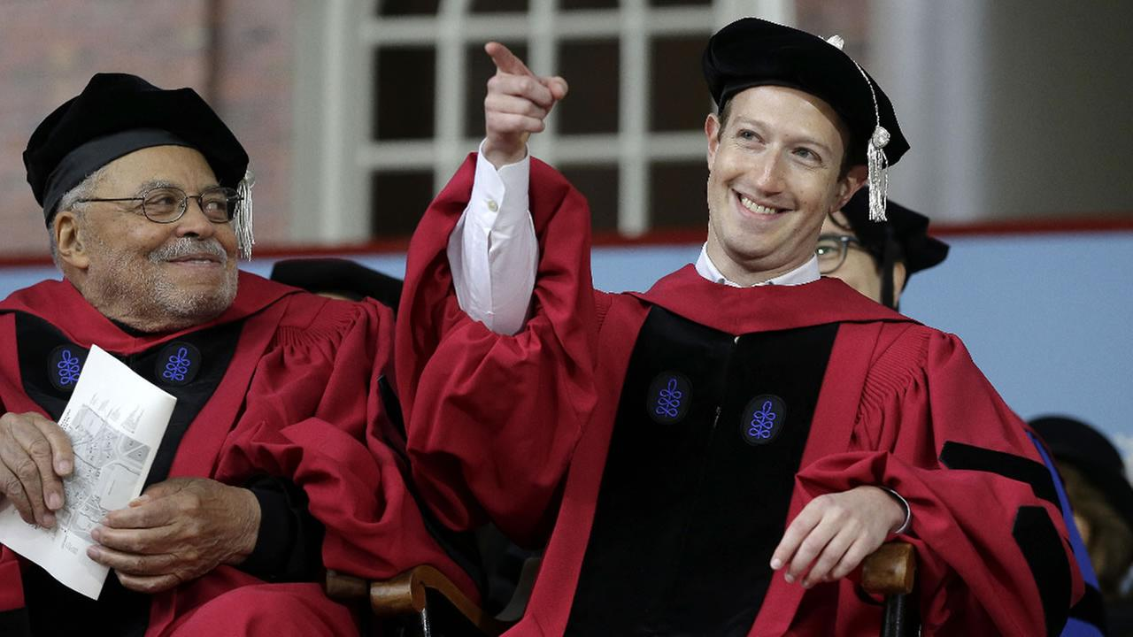 Mark Zuckerberg gestures while seated on stage during Harvard University commencement exercises, Thursday, May 25, 2017, in Cambridge, Mass.