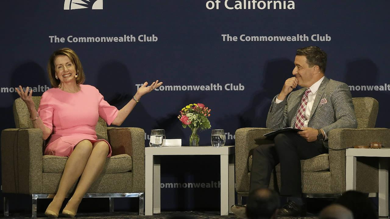 House Minority Leader Nancy Pelosi, of Calif., left, smiles while speaking to Scott Shafer at The Commonwealth Club in San Francisco, Tuesday, May 30, 2017.