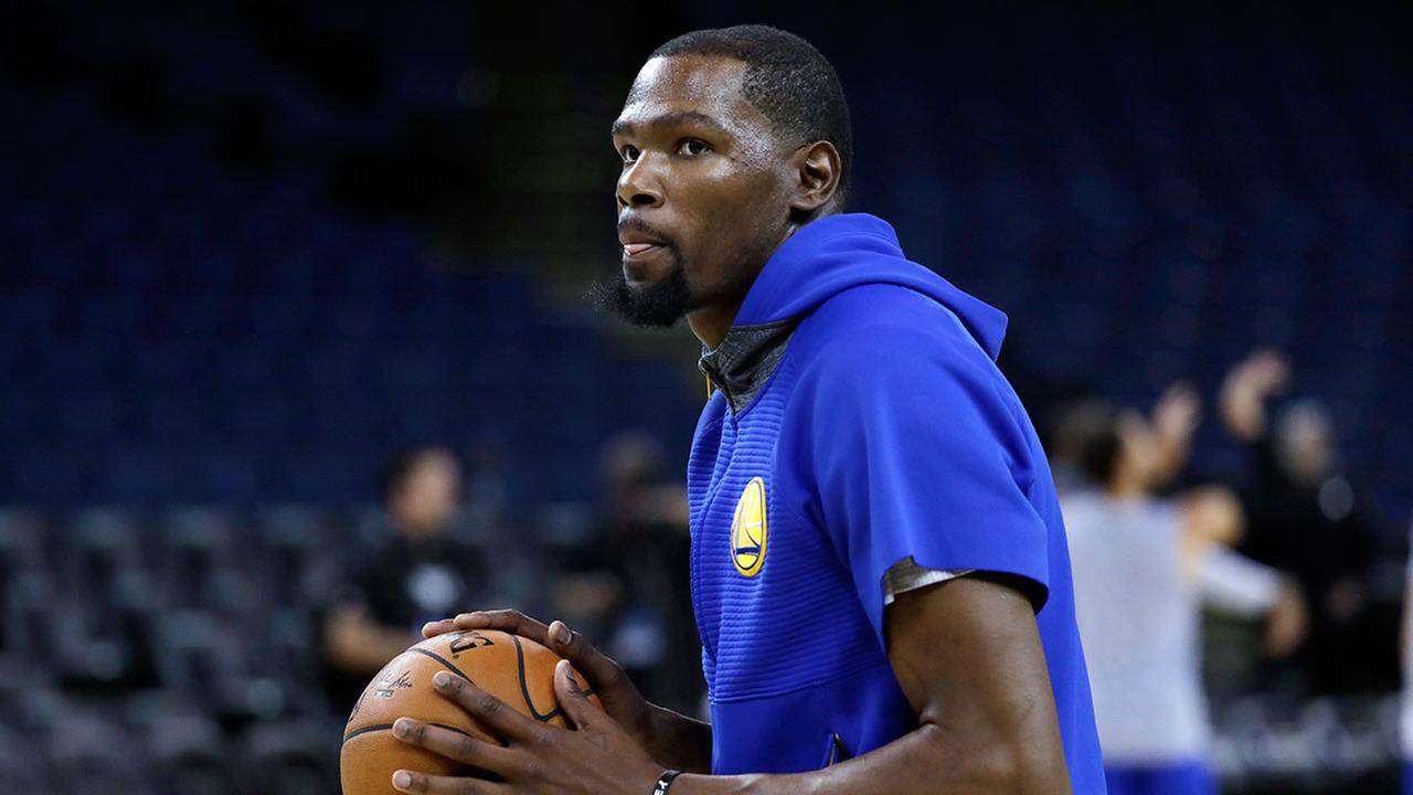 Golden State Warriors Kevin Durant prepares to shoot during an NBA basketball practice, Wednesday, May 31, 2017, in Oakland, Calif.