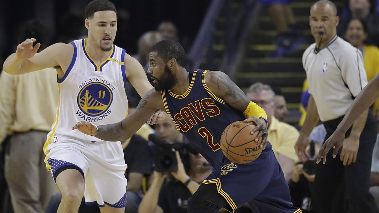 Cavaliers guard Kyrie Irving drives against Warriors guard Klay Thompson (11) during the first half of Game 1 of basketballs NBA Finals in Oakland, Calif., Thursday, June 1, 2017.