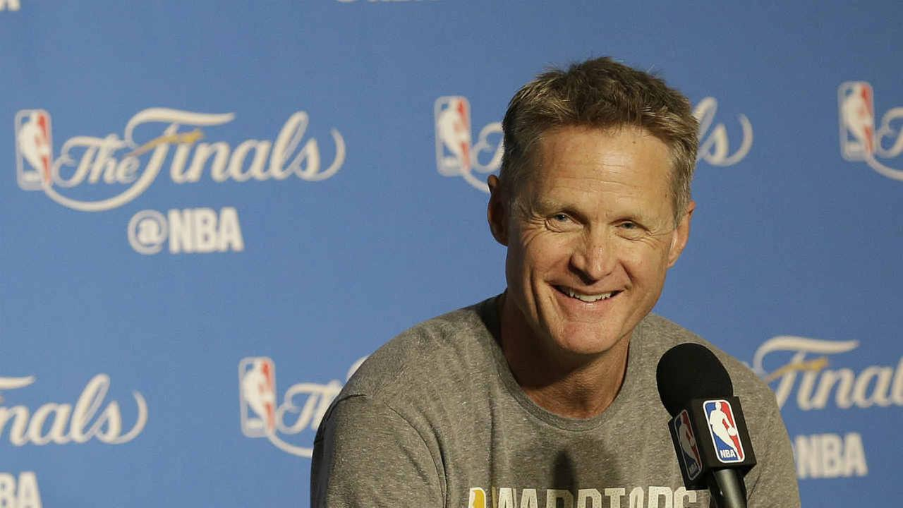 Golden State Warriors head coach Steve Kerr smiles while speaking at a news conference before Game 2 of basketballs NBA Finals.