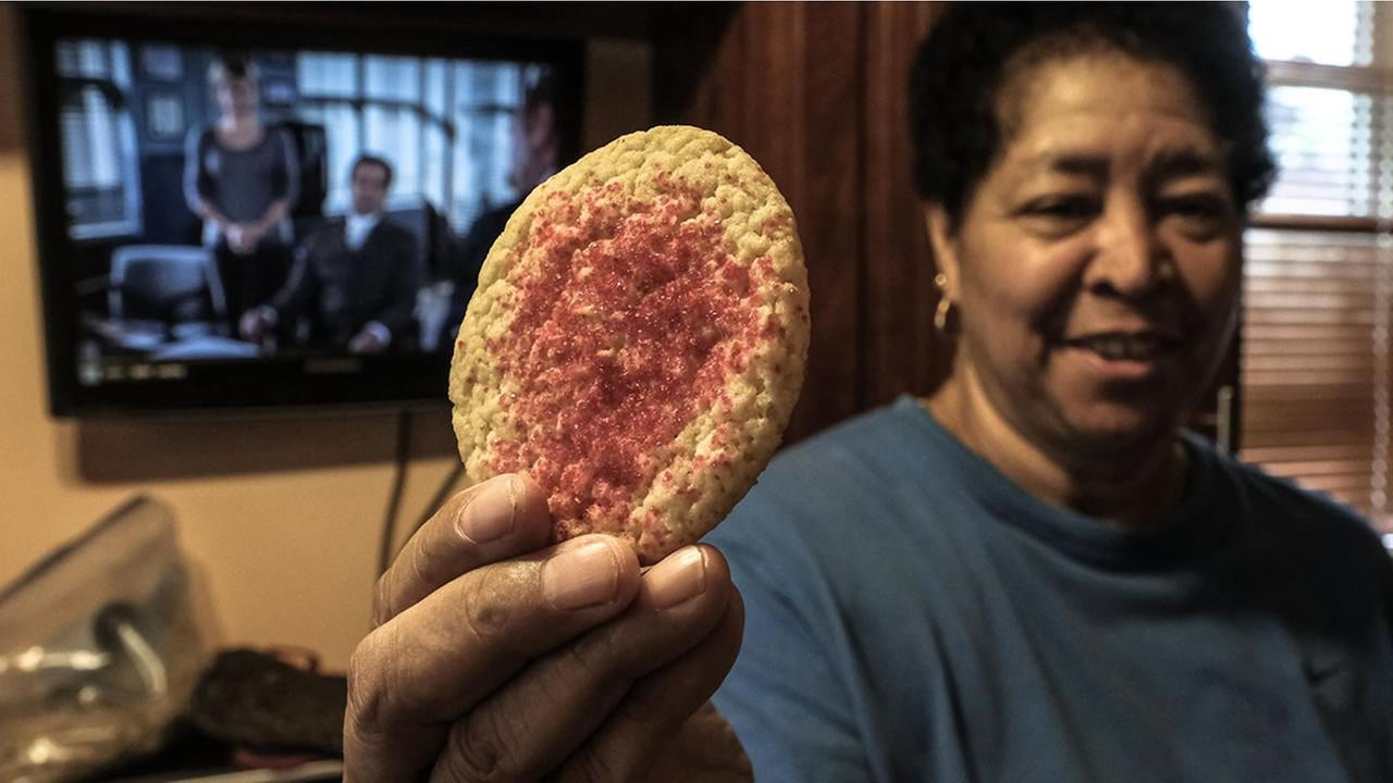 The Cleveland Cookie Lady Diane Simon shows off one of her delicious creations in Cleveland, Ohio on June 8, 2017.