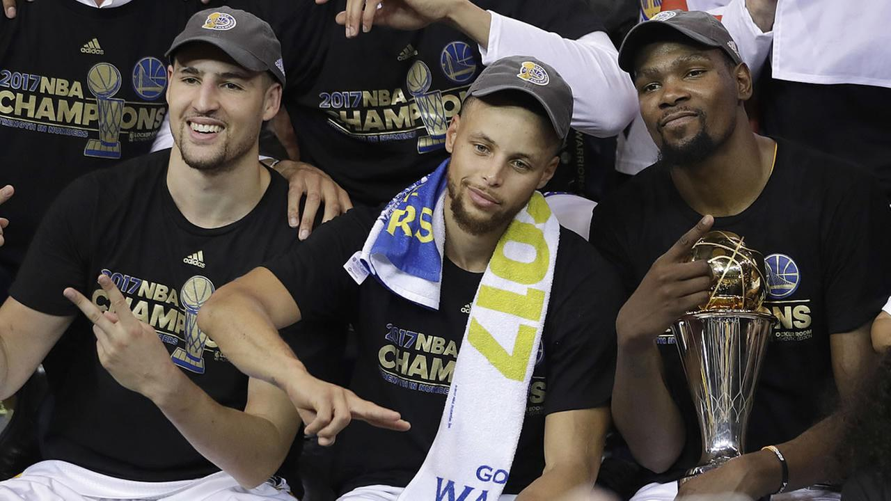 Warriors guard Klay Thompson, from left, guard Stephen Curry and forward Kevin Durant celebrate after Game 5 of the NBA Finals against the Cavaliers in Oakland, Calif., Monday, June 12, 2017. (AP Photo/Marcio Jose Sanchez)