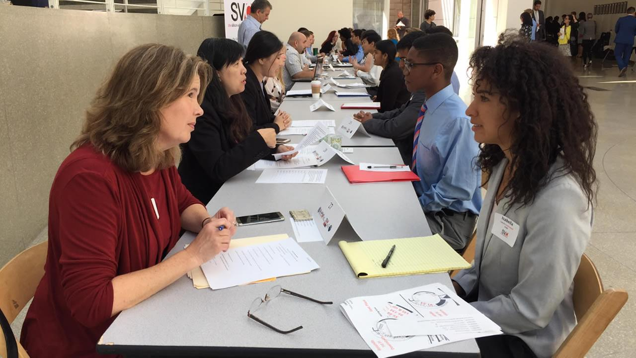 Students are seen taking part in job interviews for a summer internship program in San Jose, Calif. on Tuesday, June 13, 2017.