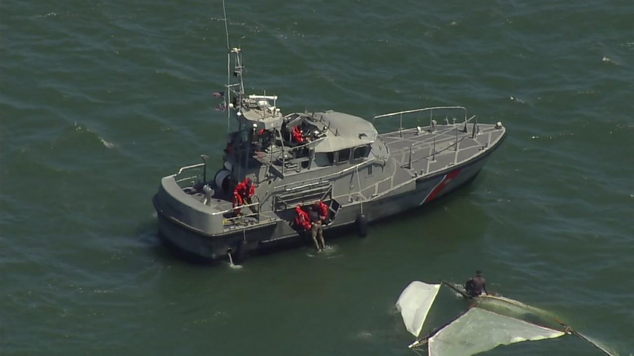 Three people were rescued after their sailboat overturned in the San Francisco Bay near the Golden Gate Bridge on Wednesday, June 21, 2017.