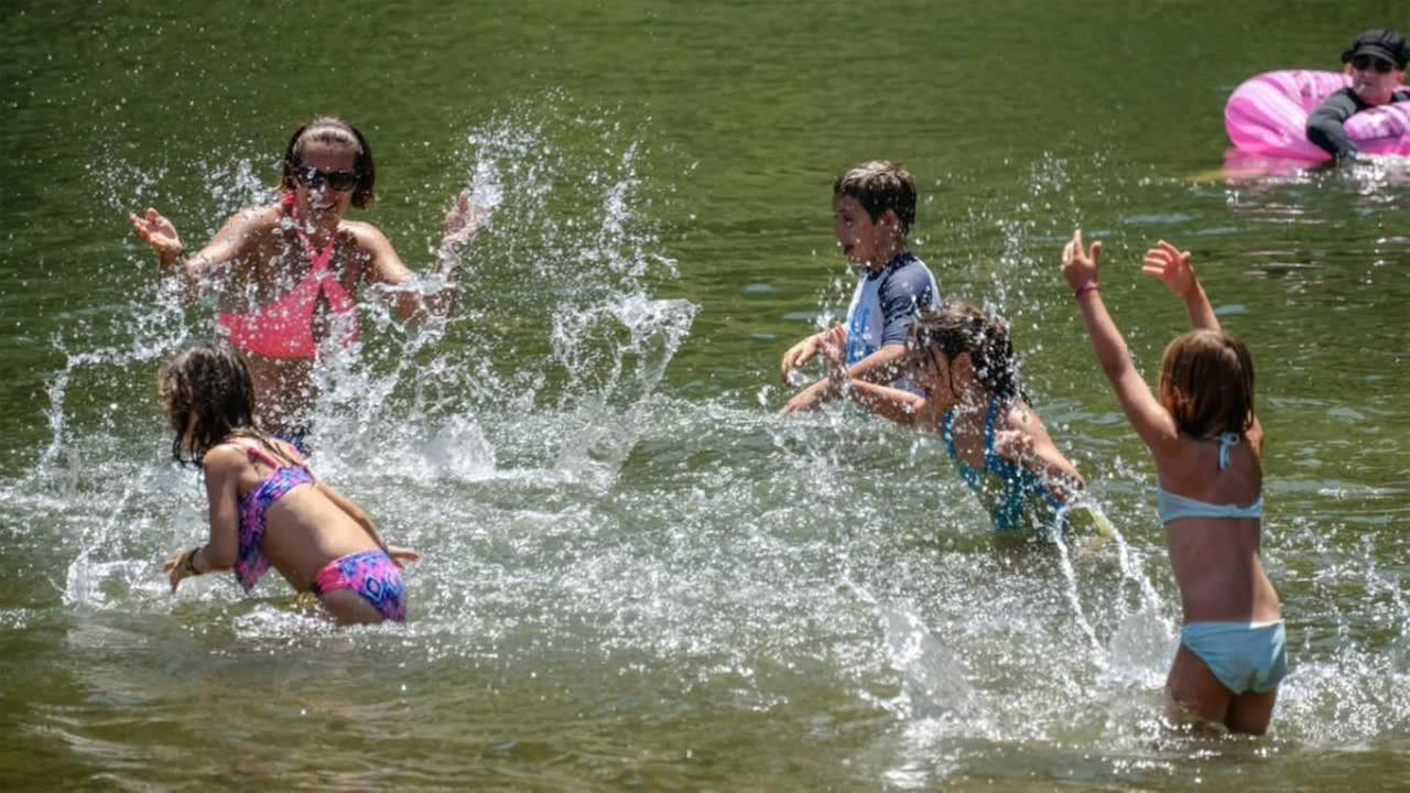 A family splashes each other at Johnsons Beach on the Russian River in Guerneville, Calif. on Wednesday, June 21, 2017.