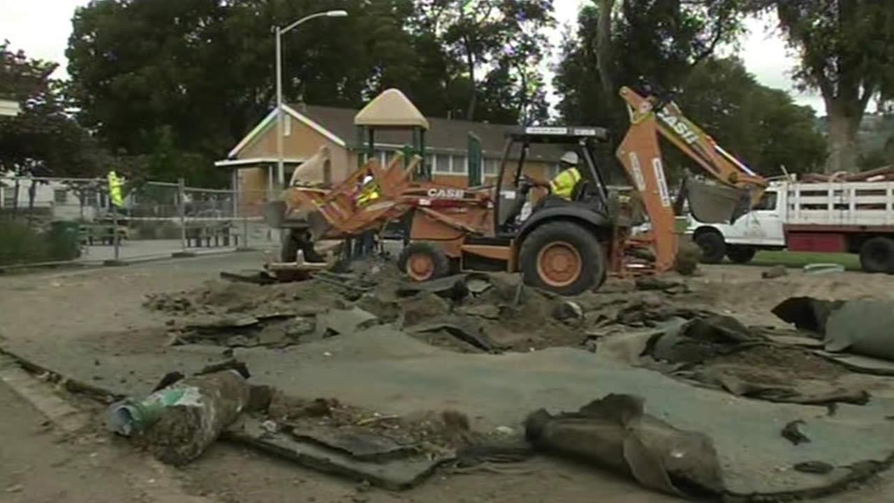 Construction crews tear down Concordia Parks old playground in Oakland.