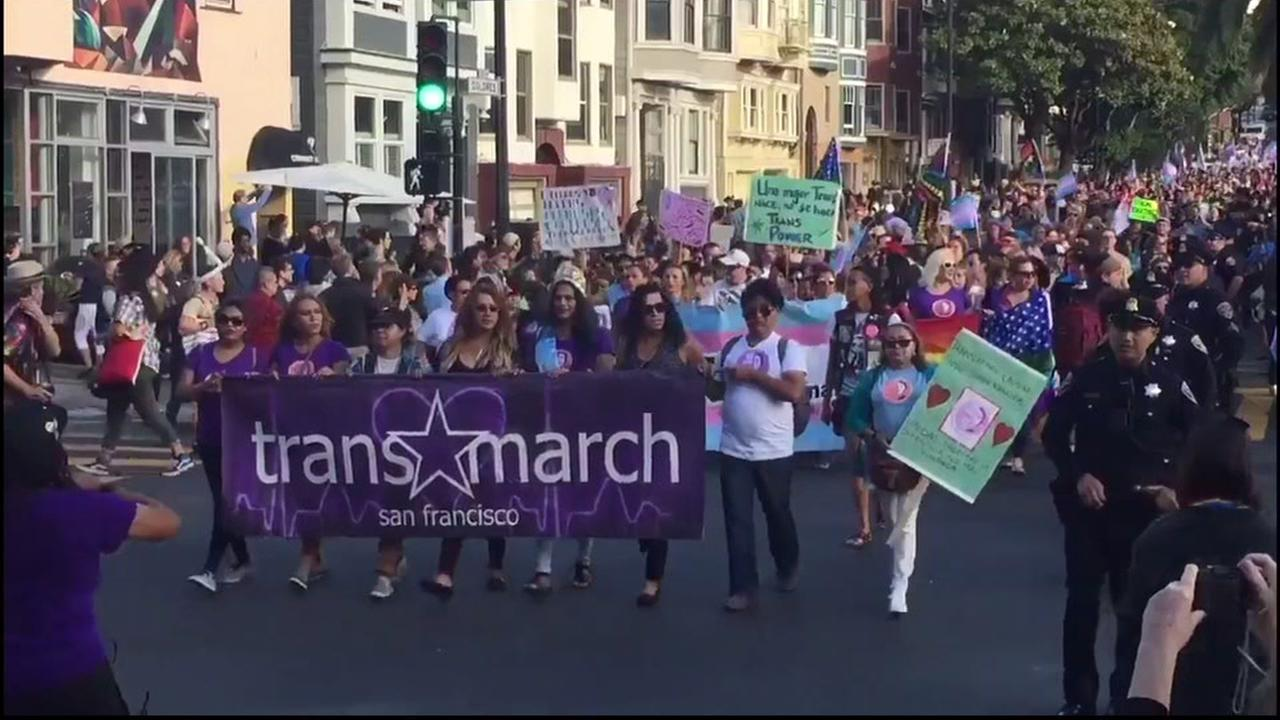 Marchers carry a sign for the transgender pride march in San Francisco, Calif. on June 23, 2017.
