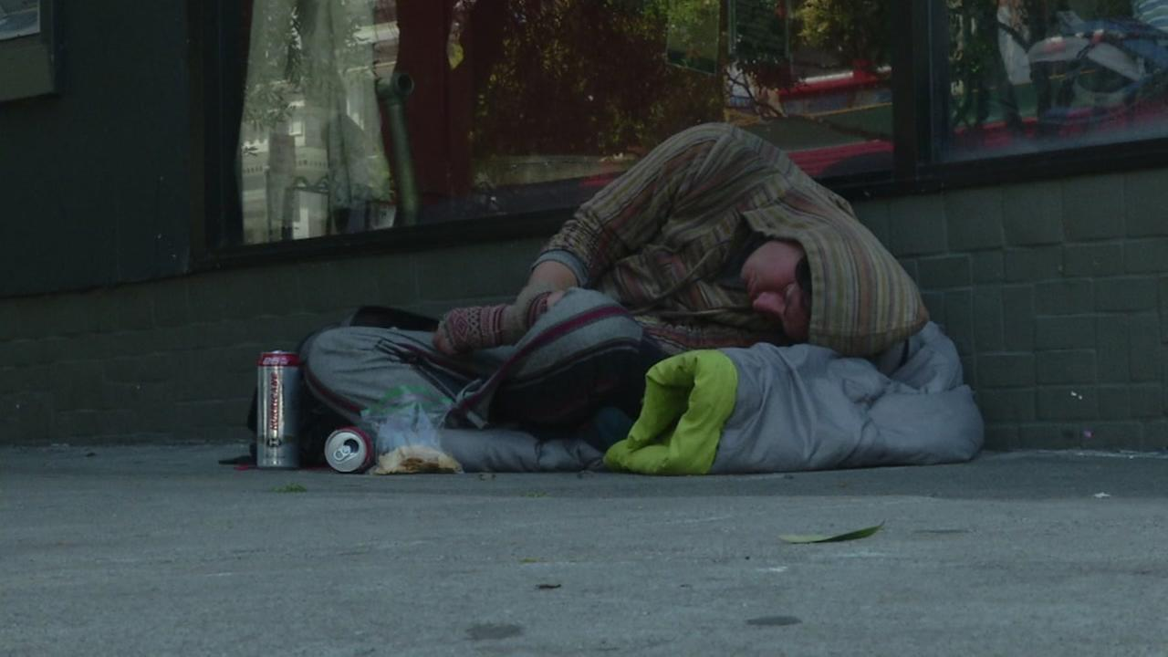 A young homeless person lays on the streets of San Francisco in this undated image.