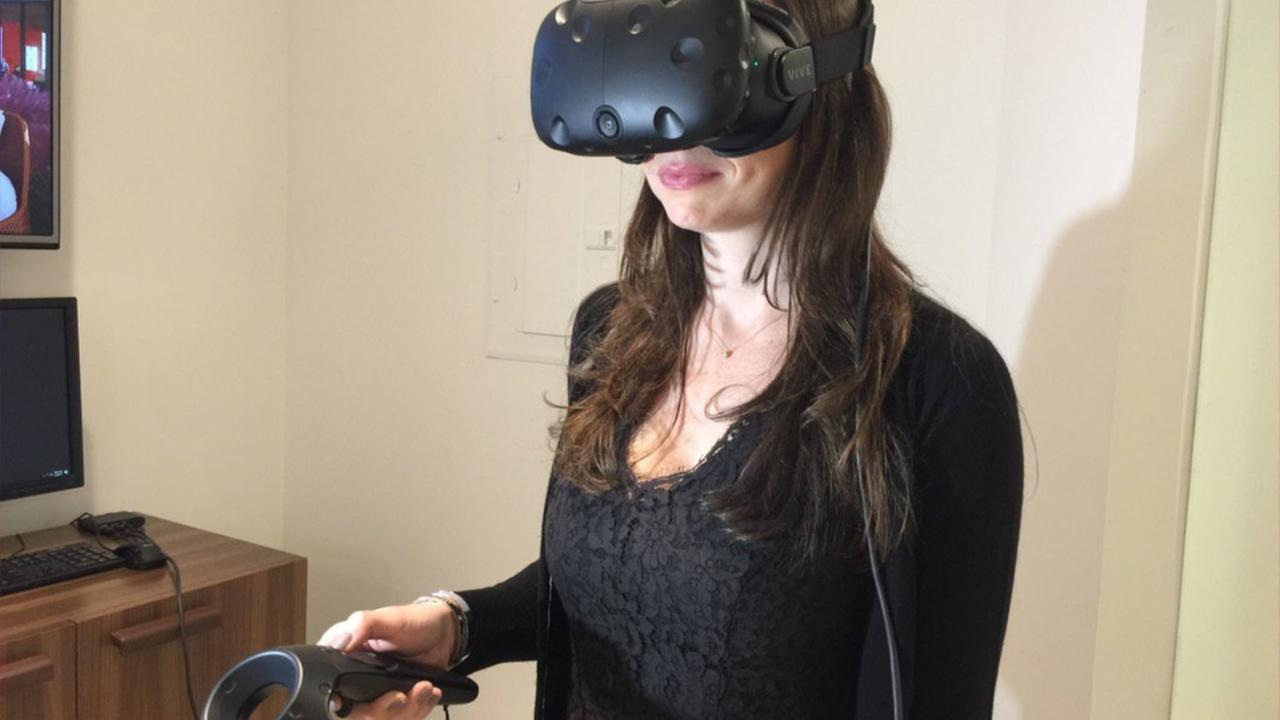 Valley Fair customer Angelina Bena-Michael of Palo Alto previews Valley Fair Malls virtual reality experience on Thursday, June 29, 2017.