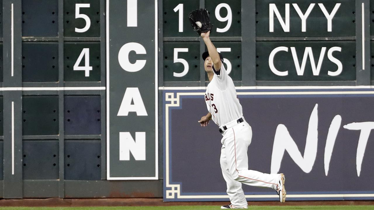 Houston Astros left fielder Norichika Aoki catches a fly ball against the Oakland Athletics during the fourth inning of a baseball game Wednesday, June 28, 2017, in Houston.