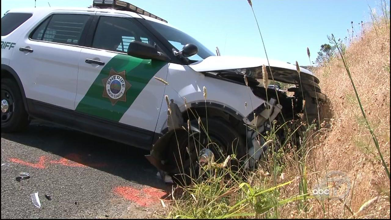 A crashed Marin County Sheriff patrol vehicle is seen near Nicasio, Calif. on Saturday, July 1, 2017.
