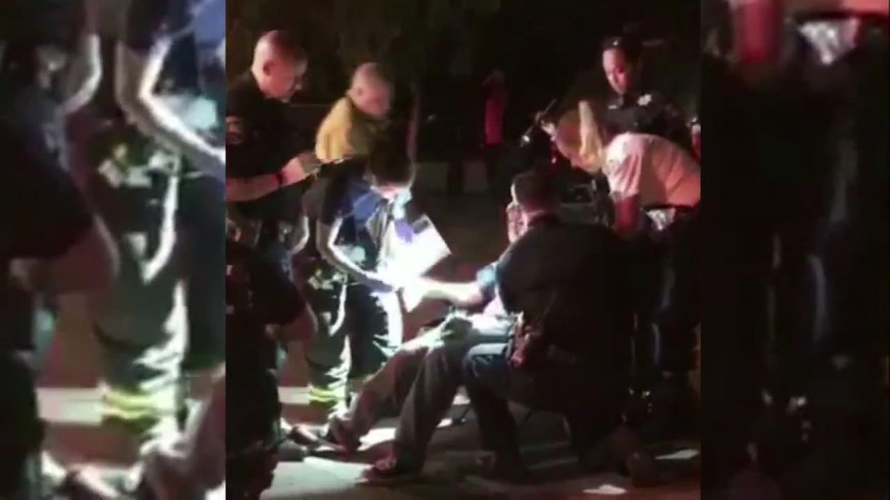 A Snapchat video shows officials helping a young man after a fireworks accident in Newark, Calif. on Tuesday, July 4, 2017.