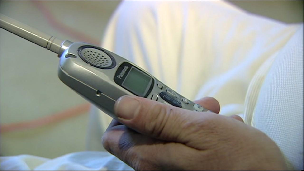 A person holds a landline phone in this undated file photo.