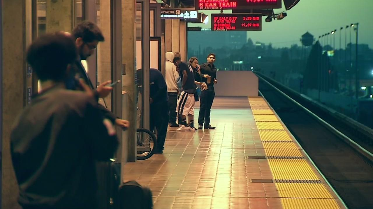 BART passengers stand on the platform at the Coliseum station in Oakland, Calif. on Wednesday, July 6, 2017.