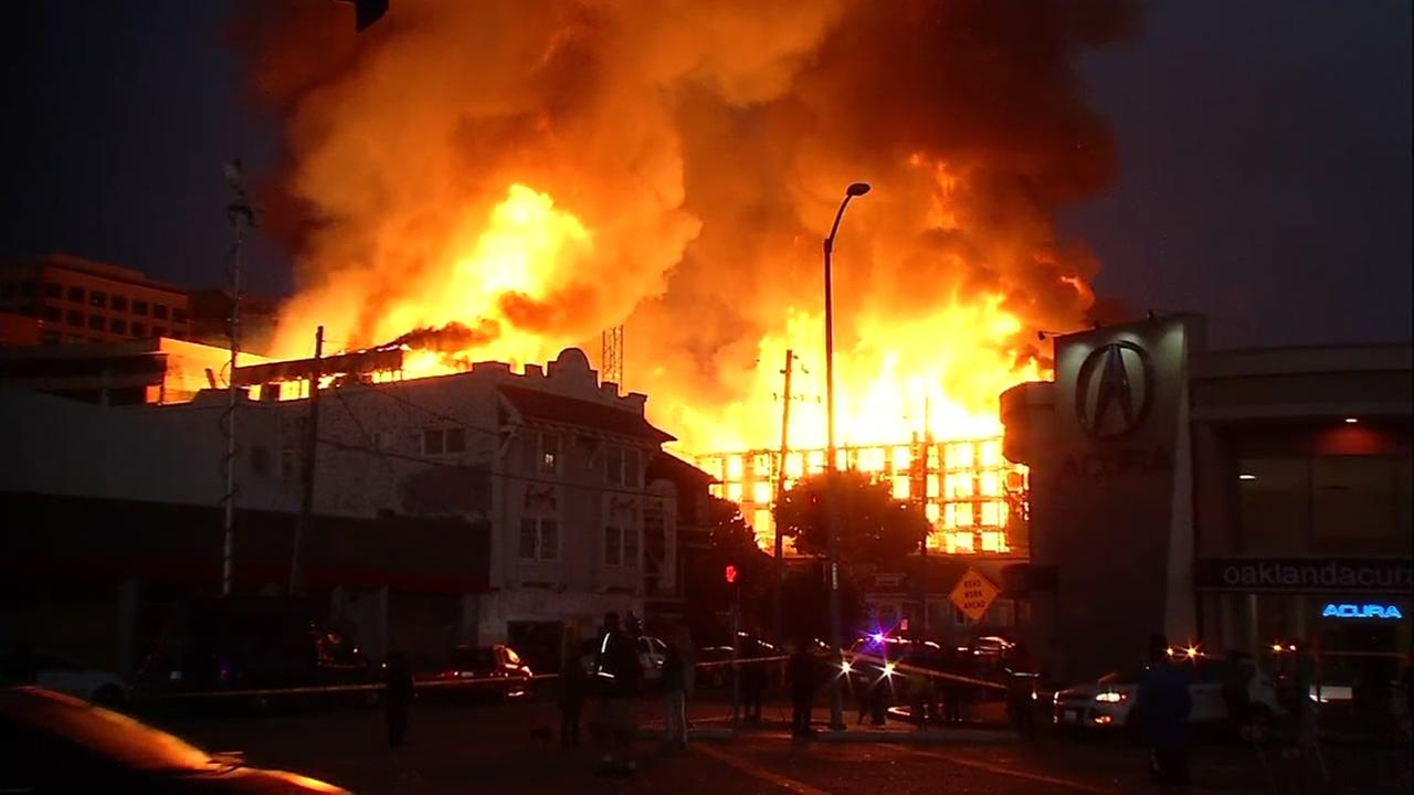 Firefighters battle massive structure fire in Oakland, California, Friday, July 7, 2017.