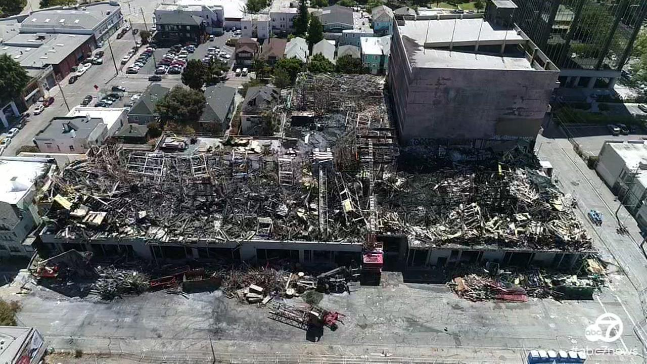 DroneView7 captured video on Monday, July 10, 2017 in Oakland, Calif. of the aftermath of a four-alarm fire that destroyed a building that was under construction.