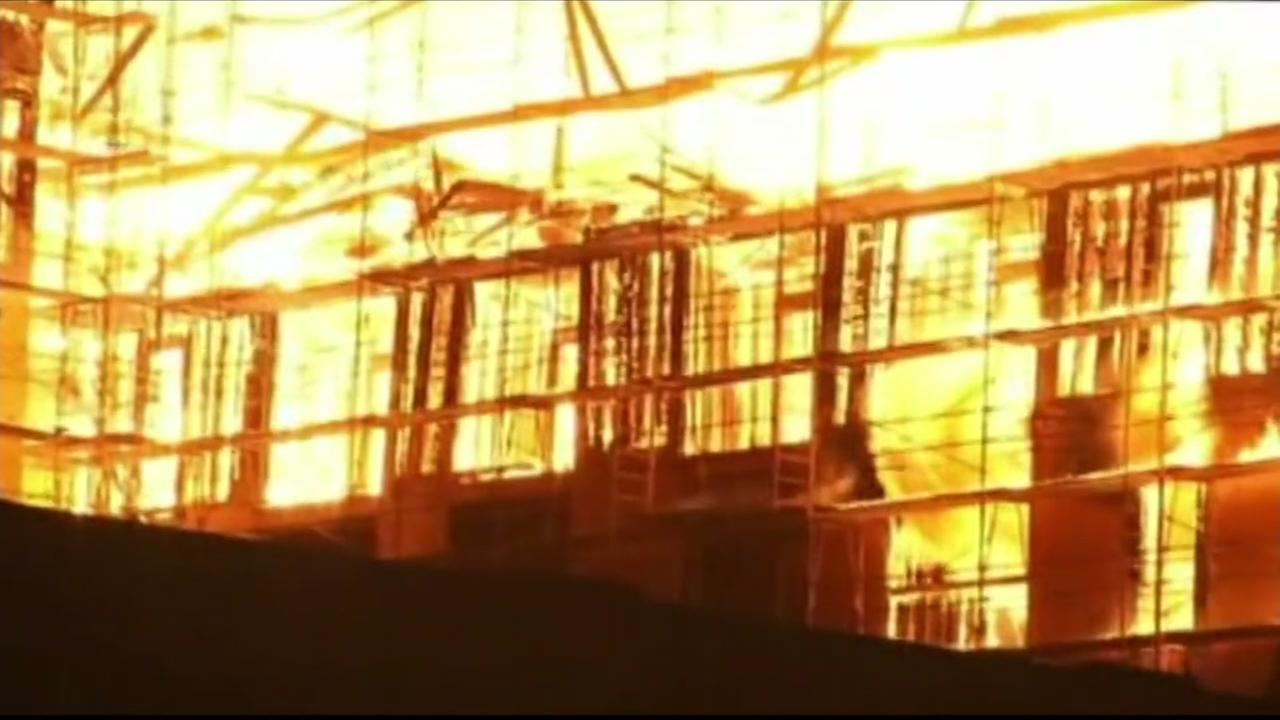 Flames are seen shooting out of a building under construction on Friday, July 7, 2017, in Oakland, Calif.