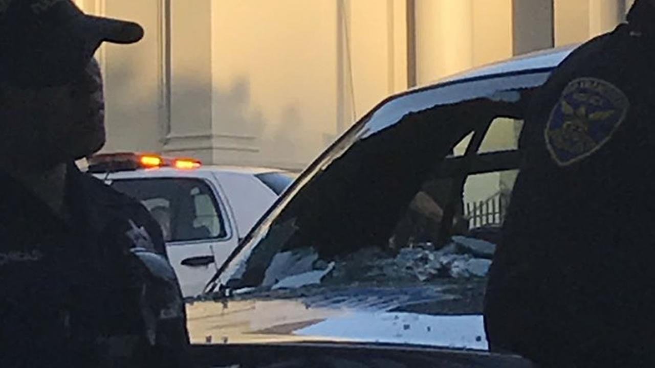 A police car window appears smashed on Tuesday, July 11, 2017.