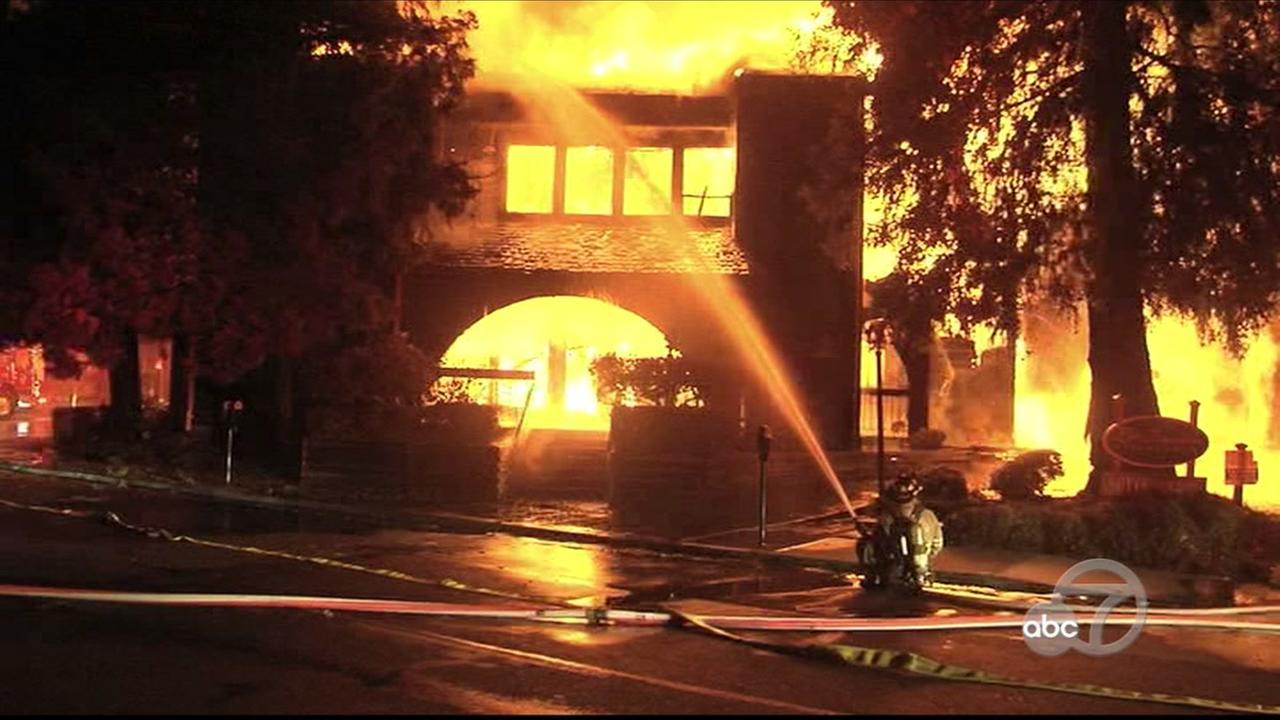 Firefighters battle fire in Lafayette, California, Thursday, July, 13, 2017.