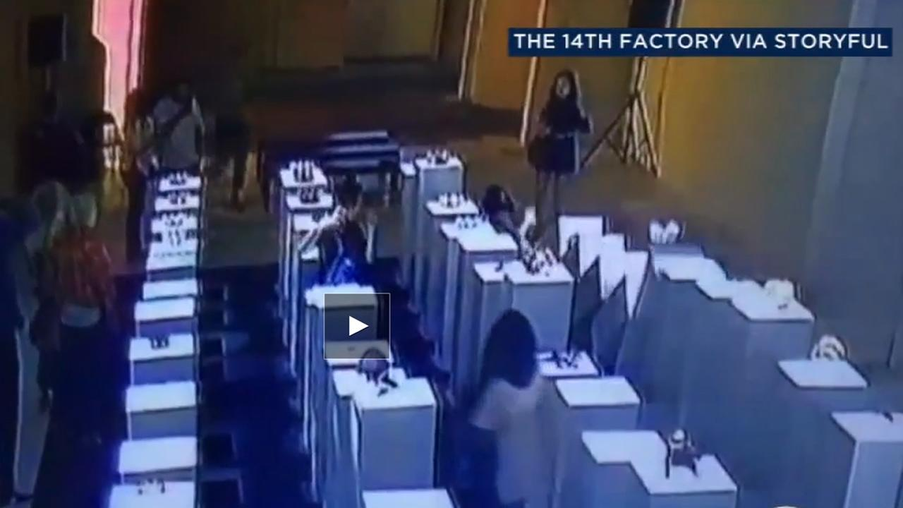 Video shows a woman knocking down hundreds of thousands of dollars worth of art at an LA exhibit.