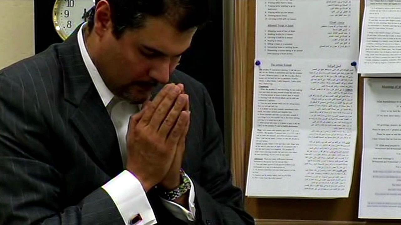 Dr. Hani Jamah, D.D.S. prays