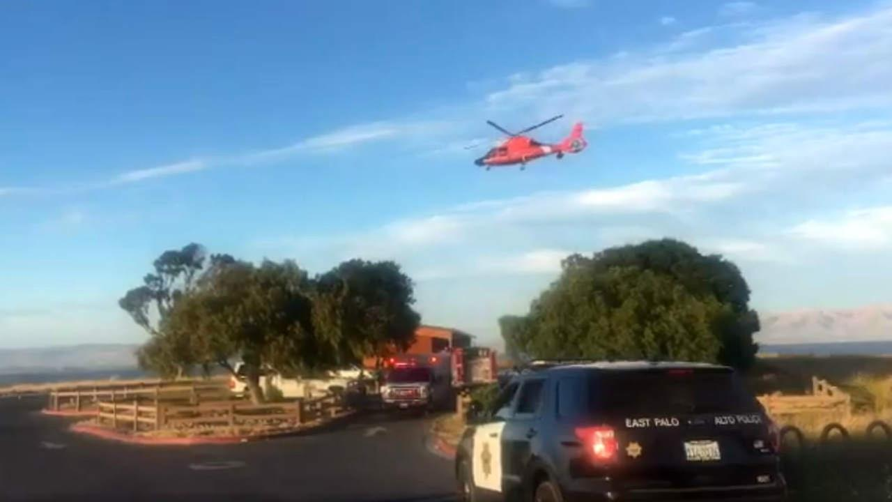 Rescue officials are seen in East Palo Alto, Calif. during a water rescue after three people went into San Francisco Bay after a boat capsized.