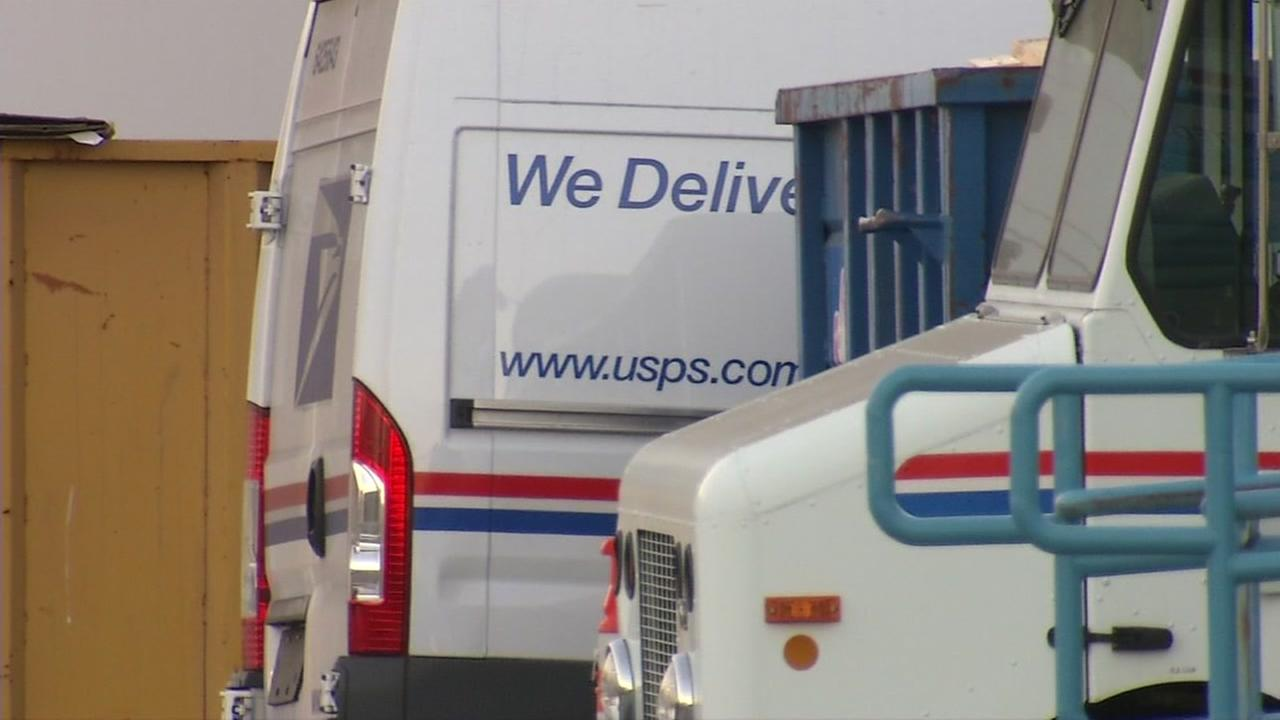 Mail trucks are seen in San Jose, Calif. on Wednesday, July 19, 2017.