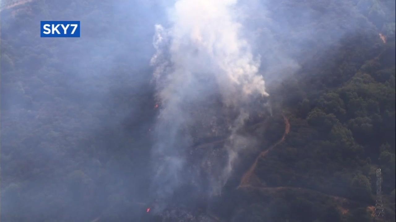 A vegetation fire burns in Saratoga, Calif. on Wednesday, July 19, 2017.