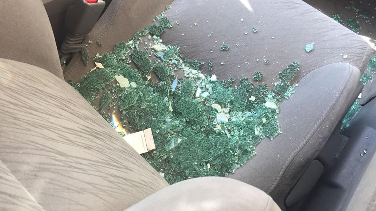 A car is seen with its window smashed in Livermore, Calif. on Saturday, July 22, 2017.