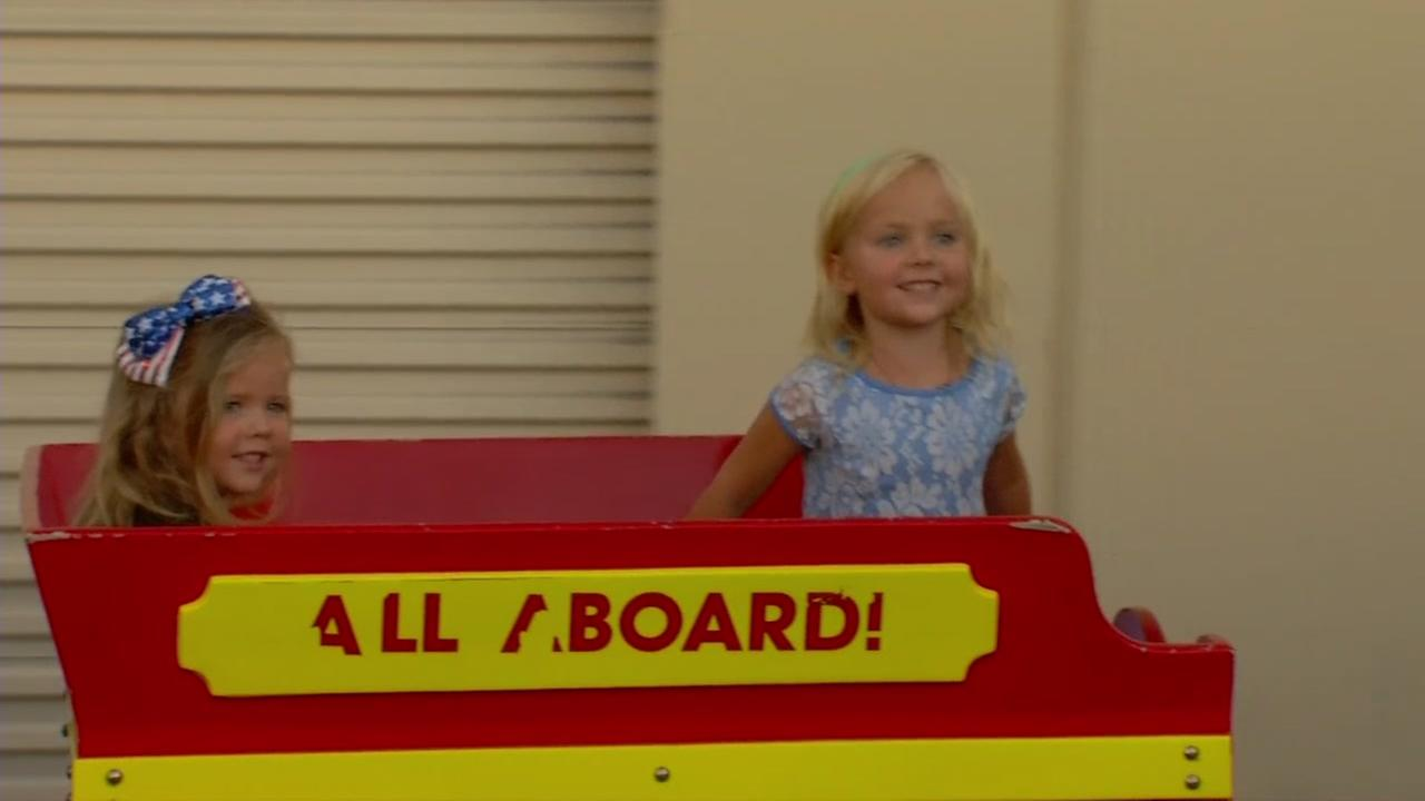 Children ride a train that was recently recovered in Walnut Creek, Calif. after being stolen from Pleasant Hill, Calif. on Monday, July 31, 2017.