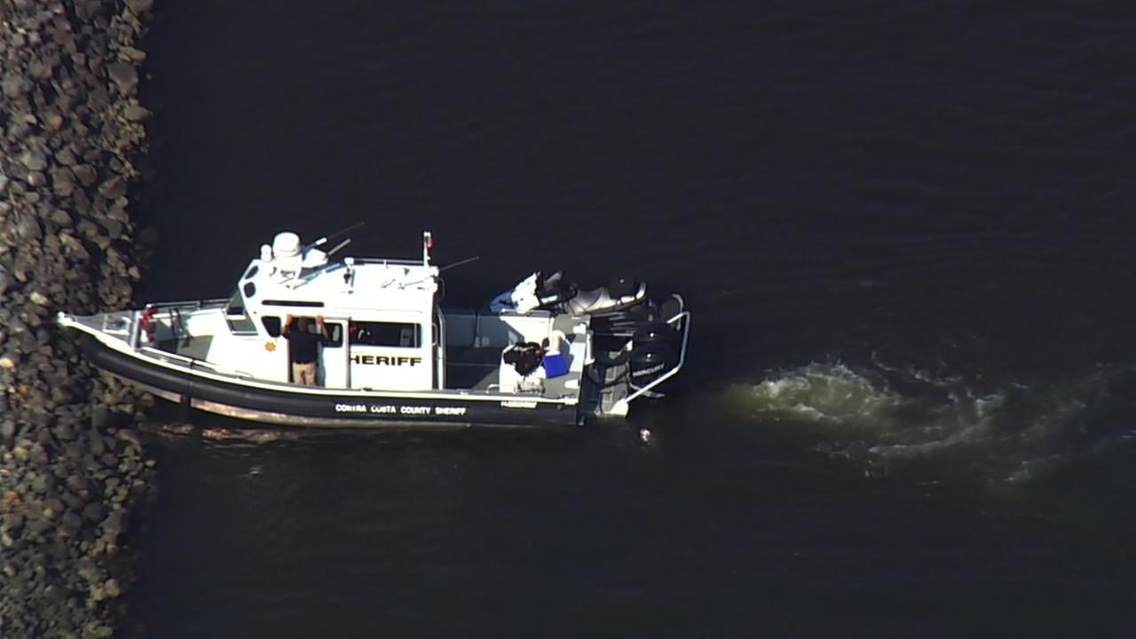 A sheriffs boat appears near Highway 4 in Discovery Bay, Calif. on Wed., Aug 9, 2017.