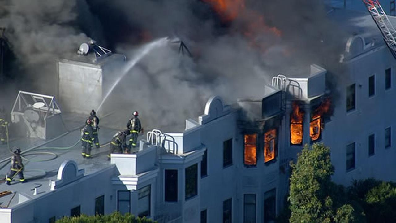 Fueled by heavy wind gusts, structures are on fire in San Franciscos Western Addition.
