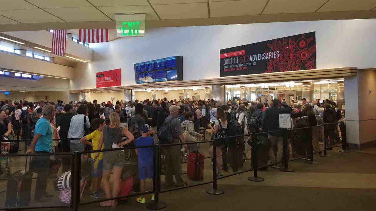 Passengers are seen gathered at San Jose Mineta International Airport on Saturday, August 12, 2017 after a security incident at one of the terminals.