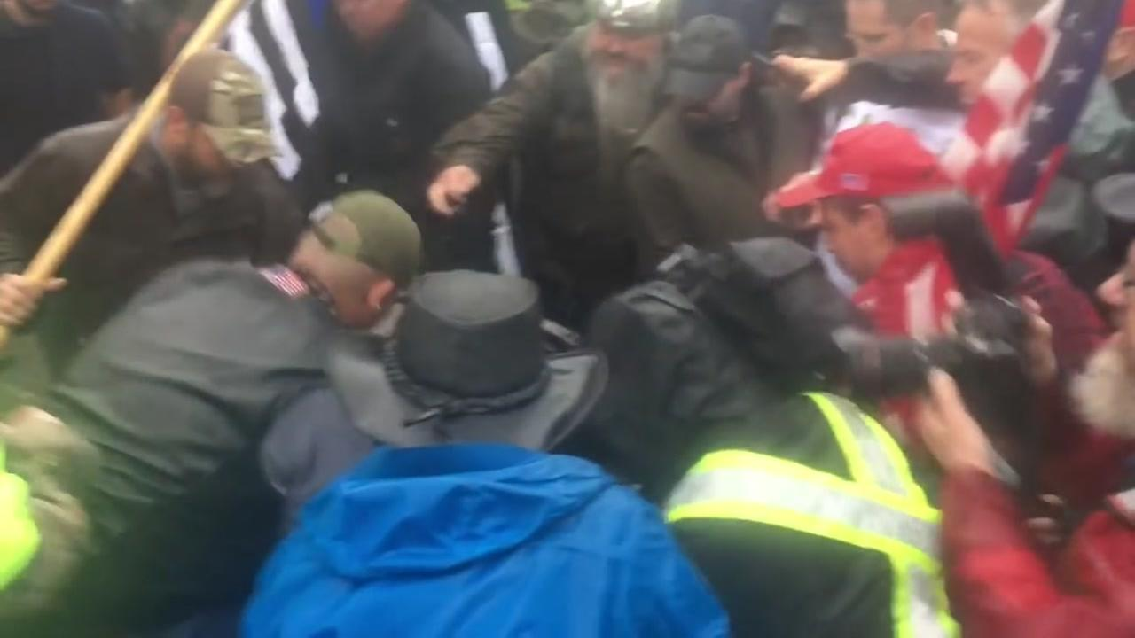 This is an undated image of a fight between protesters.
