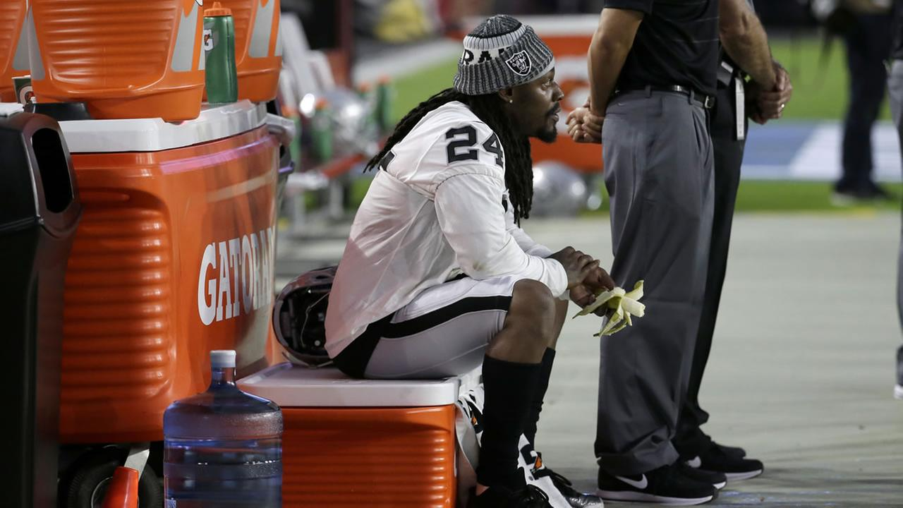Oakland Raiders running back Marshawn Lynch (24) sits during the national anthem prior to an NFL preseason football game against the Arizona Cardinals, Saturday, Aug. 12, 2017.