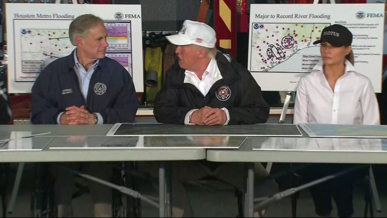 President Donald Trump and First Lady Melania Trump discuss Hurricane Harvey in Houston on Aug. 29, 2017.