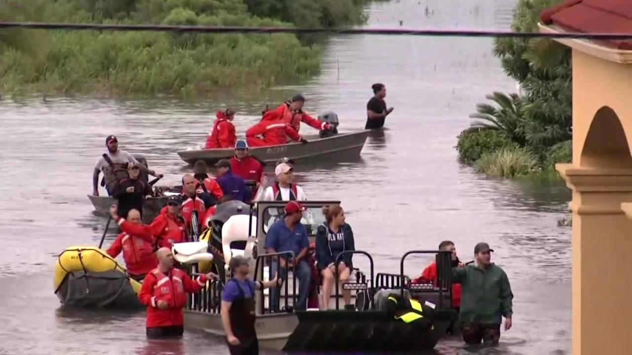 Boats rescue Hurricane Harvey evacuees in Aug. 2017.