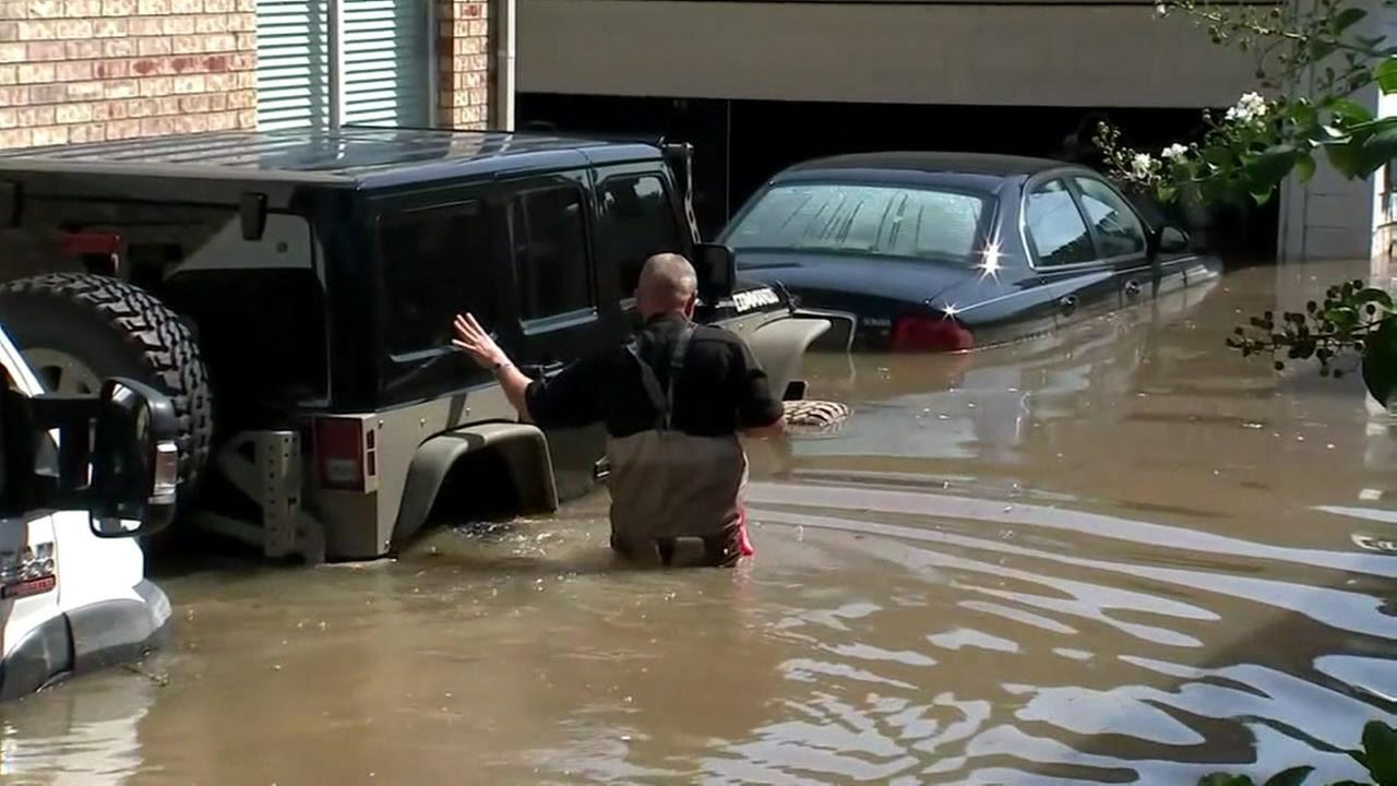 A man wades through floodwaters in Houston, Texas in Aug. 2017.